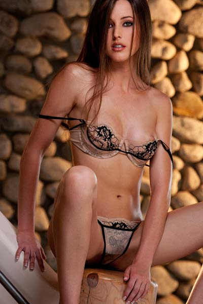 Model Erica Ellyson in Strips By A Stone Wall